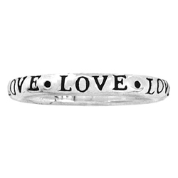 "Sterling silver ring with the word ""love"" inscribed on it"