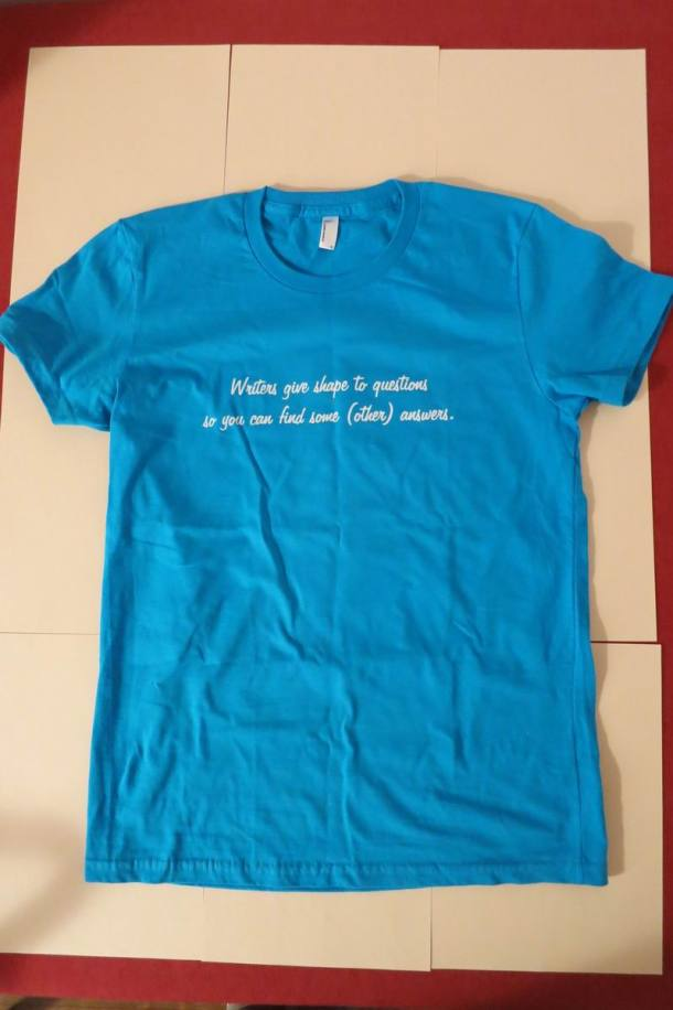 Turquoise tee_writers give shape to questions quote